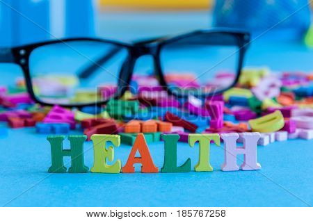 Health - word composed of small colored letters on business workplace of doctor, medic or dentist.