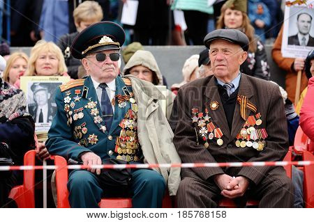 Orel Russia - May 9 2017: Celebration of 72th anniversary of the Victory Day (WWII). Senior Soviet veterans in uniform with medals closeup