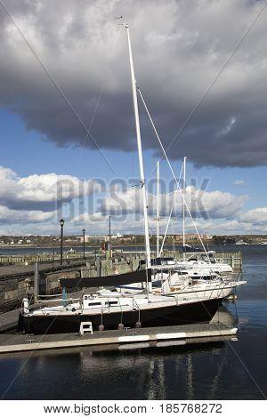 The row of yachts under the dark cloud in Halifax marina (Nova Scotia).