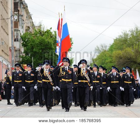 Orel Russia - May 9 2017: Celebration of 72th anniversary of the Victory Day (WWII). Cadets marching with Russian flag on square