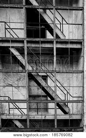 Exterior stairs on abandoned building deteriorating on old industrial building.