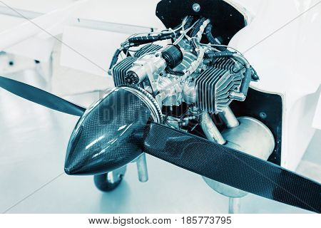 Airplane engine on small aircraft detailed view of engine propeller and cone.
