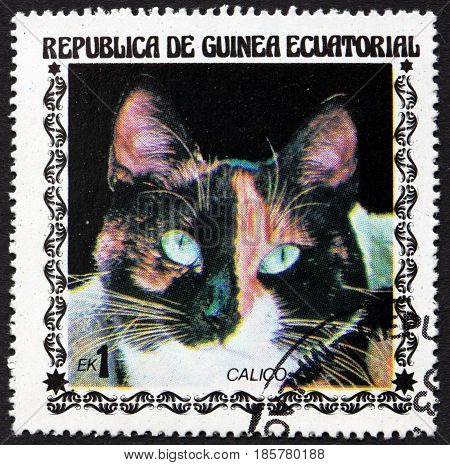 EQUATORIAL GUINEA - CIRCA 1978: a stamp printed in Equatorial Guinea shows Calico Cat Felis Silvestris Catus a Domestic Cat circa 1978