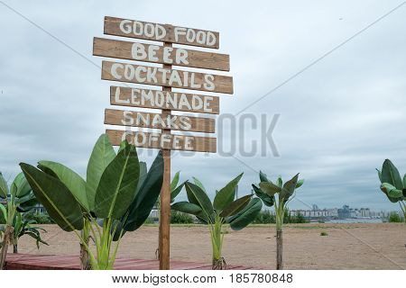 Cafe wooden signpost. Summer and holiday landscape