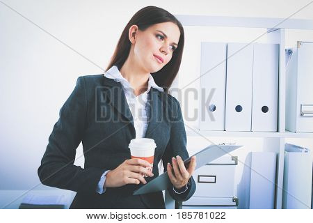 Business woman with a folder and paper cup of coffee