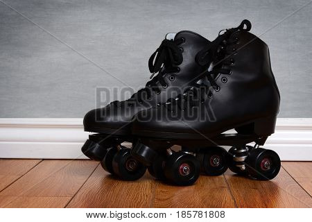 men's quad roller skates on wood floor