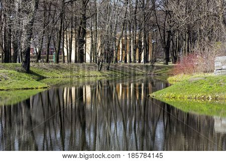 expanse of water lake pond Park trees reflected in water spring