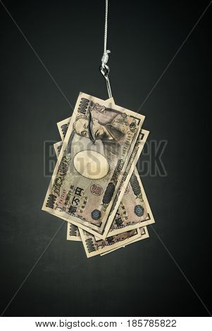 yen money on hook economy concept