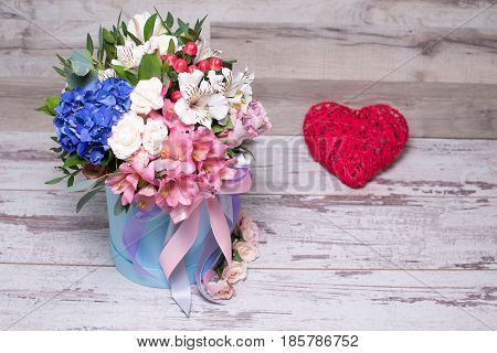Beautiful Floral Arrangement In Hat Box With Action Figure Heart , Shabby White Wooden Table