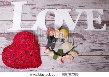 Figurines Of The Bride And Groom That Symbolizes The Commitment To Love