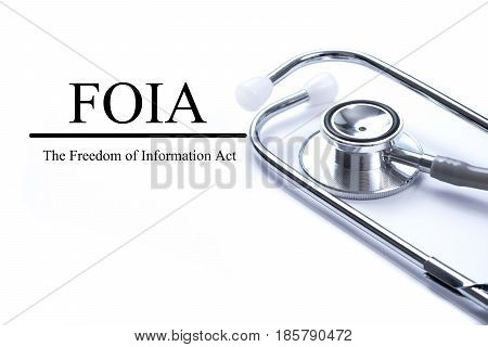 Page with FOIA (The Freedom of Information Act) on the table with stethoscope medical concept.