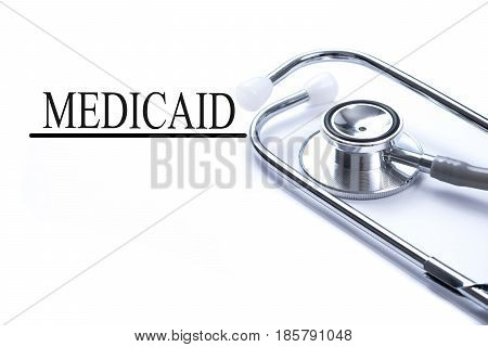 Page with medicaid on the table with stethoscope medical concept