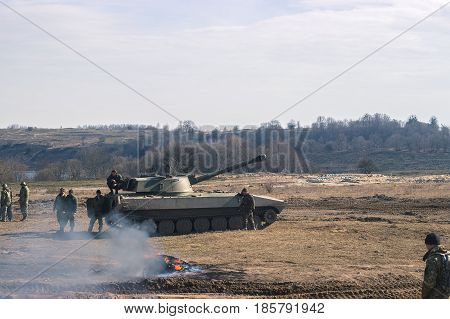 Battle Tanks moving in the desert. War scene NATO decoration. Battlefield.