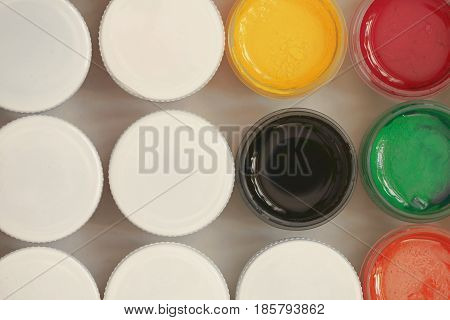 Colorful Gouache set of artistic cans Macro shot top view