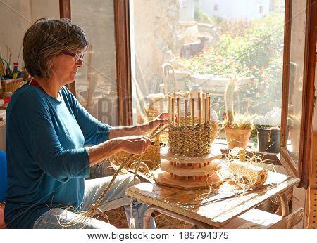 Esparto halfah grass crafts craftsman woman hands working
