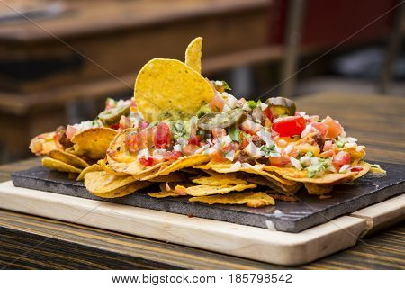 Plate of nachos flavored with vegetables of different flavors and textures