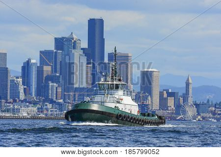 Tug transits Elliott Bay - Seattle WA