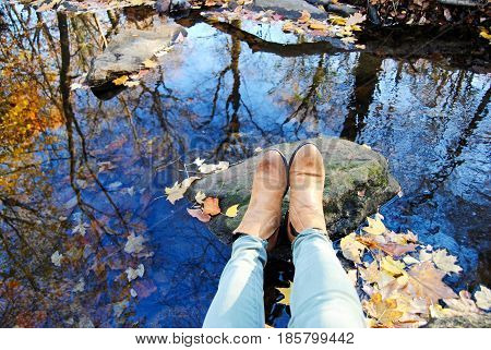 leather booties and green pants in the fall sitting on a rock in a stream with a reflection from the trees  air,autumn,blue,booties,boots,breathe,color,colorful,crisp,dead,dying,fall,foliage,fresh,glisten,gray,green,lake,leather,life,meditation,mindful,na