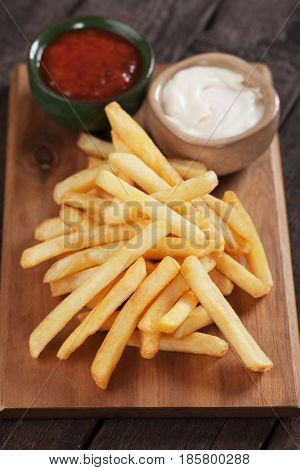 French fries, fried potato sticks with ketchup and mayonnaise