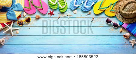 Four Pair Flip flops With Hats And Sunglasses On Wooden Deck