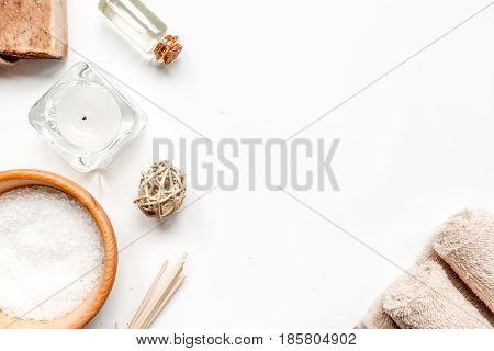 spa composition for body care with sea salt on white background top view mock up