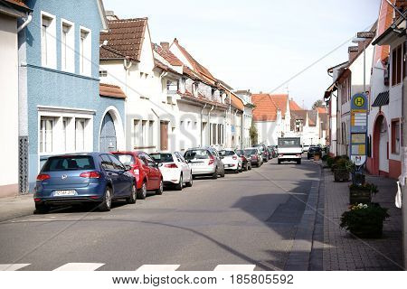 MAINZ, GERMANY - MARCH 22: The main traffic route of the district Gonsenheim with adjoining houses as well as parking spaces on March 22, 2017 in Mainz.