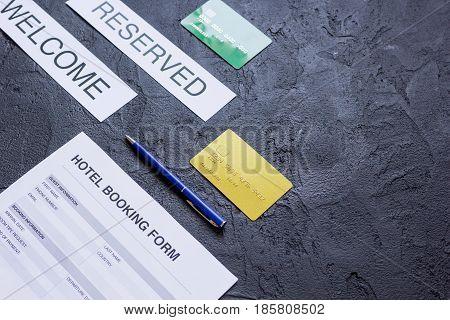 room reservation form on hotel reception dark desk background