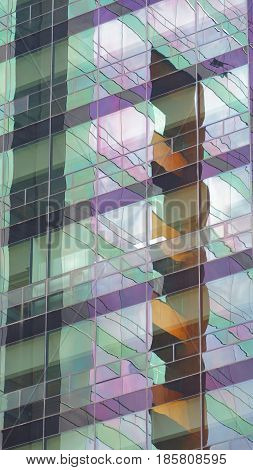Modern building with glass windows reflected sky. Background in vertical format