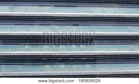 Modern building with glass windows reflected sky. Background in horizontal format