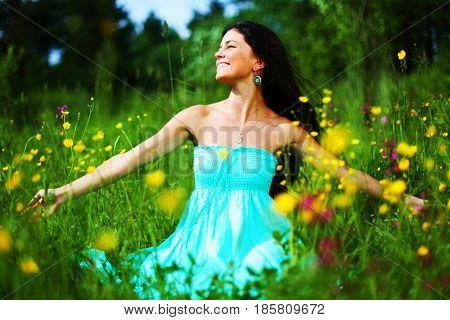 woman on summer flower field feel freedom