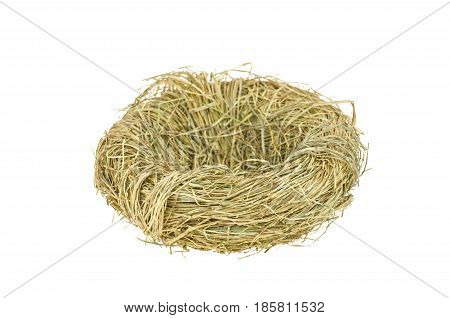Birds nest on a white background. Nest of straw isolated on white background