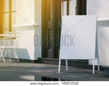 White blank menu board on sidewalk. Sunny day with rays of light. 3d rendering