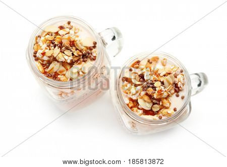 Delicious parfait with granola in jar on white background