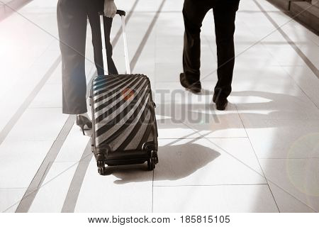 Businessman and secretary hold luggage business trip
