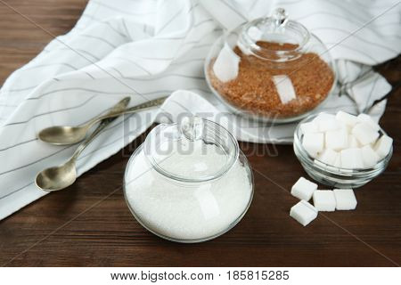 Beautiful composition with sugar on wooden background
