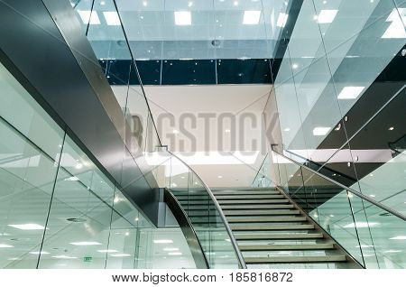 Staircase looking upwards in office building interior