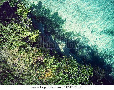 Aerial view of coast with cliffs and turquoise sea. Top view. Bohol, Philippines 2016.