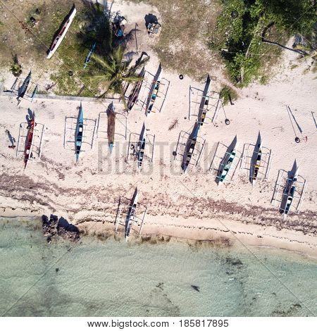 Aerial view of beach with bangkas fishing boats. Top view. Bohol, Philippines 2016.