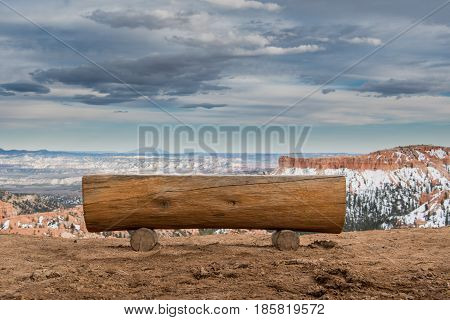 Low Angle Of Park Bench Looking Out Over Snowy Hoodoos