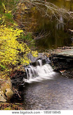 Water tumbles over Horseshoe Falls in autumn at Caesar Creek State Park near Waynesville, Ohio.