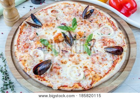 Italian pizza with seafood - octopus, calamary, mussels and clams