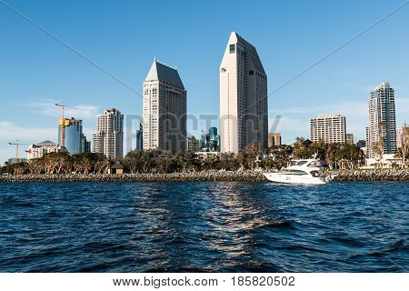 SAN DIEGO, CALIFORNIA - MARCH 2, 2017:  A yacht passes by the downtown skyline at the Embarcadero Marina Park.