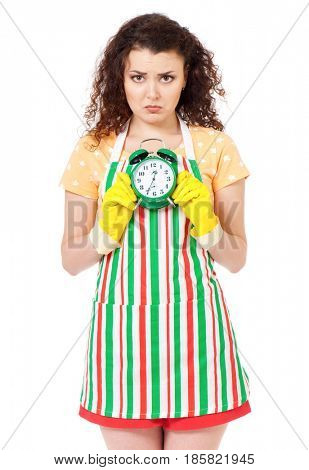 Tired sadness young housewife with yellow gloves and green alarm clock, isolated on white background