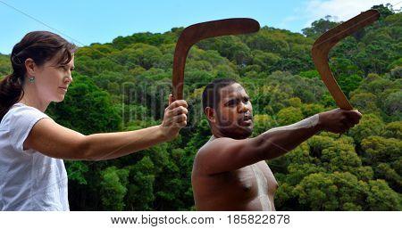 Aboriginal Warrior Man Teach Woman Tourist How To Throw A Boomerang