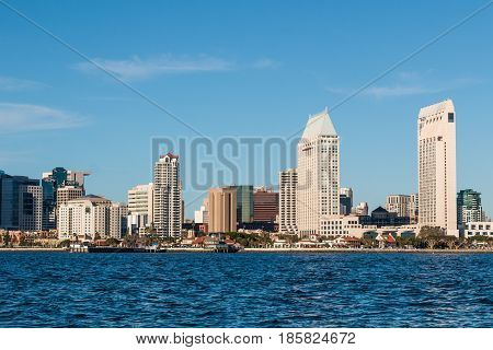 SAN DIEGO, CALIFORNIA - MARCH 2, 2017:  Seaport Village, waterfront hotels and the downtown San Diego skyline.