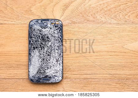 Top View Broken Of Smart Phone On Wooden Table Background
