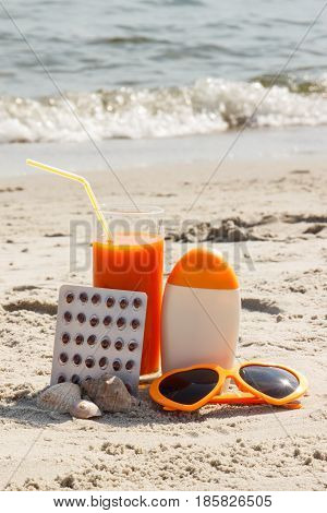 Medical Pills, Carrot Juice And Accessories For Sunbathing, Concept Of Vitamin A And Beautiful, Last