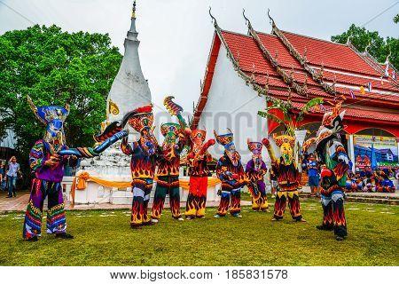 LOEI THAILAND - JUNE 27, 2015: Thai northeastern traditional Phi Ta Khon ghost mask dancer with wooden fake penis in Phi Ta Khon festival parade in Dansai of Loei, Thailand.