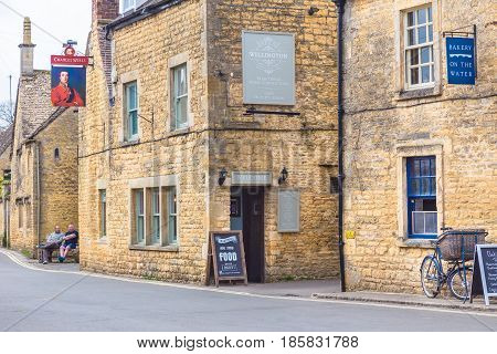 Bourton On The Water England - 7 April 2017 - Old stone buildings stand along a road in Bourton On The Water England on April 7 2017