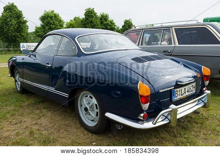 PAAREN IM GLIEN GERMANY - MAY 19: The two-door coupe Volkswagen Karmann Ghia rear view The oldtimer show in MAFZ May 19 2013 in Paaren im Glien Germany